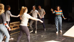 Members of the cast of Godspell have some fun during rehearsal. Northwest Catholic Dramateurs will perform their annual sprin