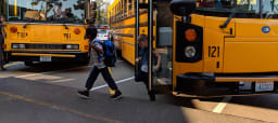 Children Getting off a School Bus