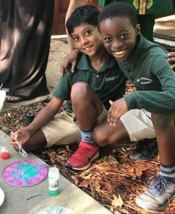 Boys creating a mandala