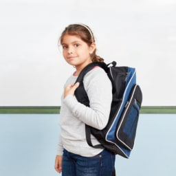 school age girl wearing a backpack