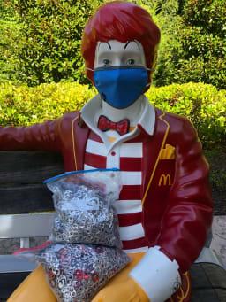 Ronald McDonald with a mask