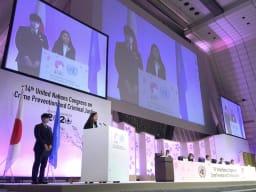 A girl standing at a podium and giving an address at an UN Congress