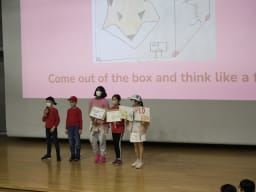 Boys and girls standing on the stage