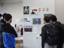 Boys looking at art pieces on the wall