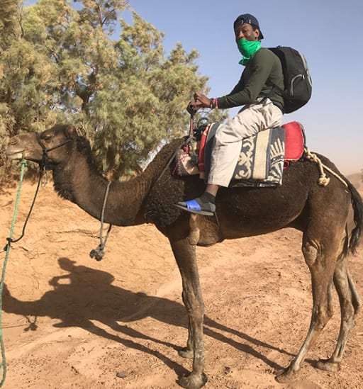 Loomis Chaffee student riding a camel in Morocco