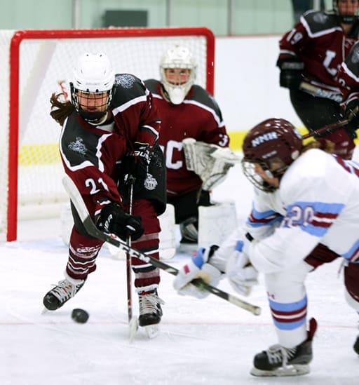 Loomis Chaffee girl's hockey team on the ice