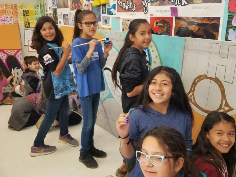 5th graders paint art mural