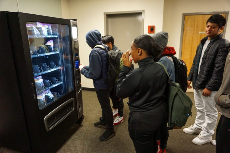 A group of Tyee students line up to use the new vending machine.