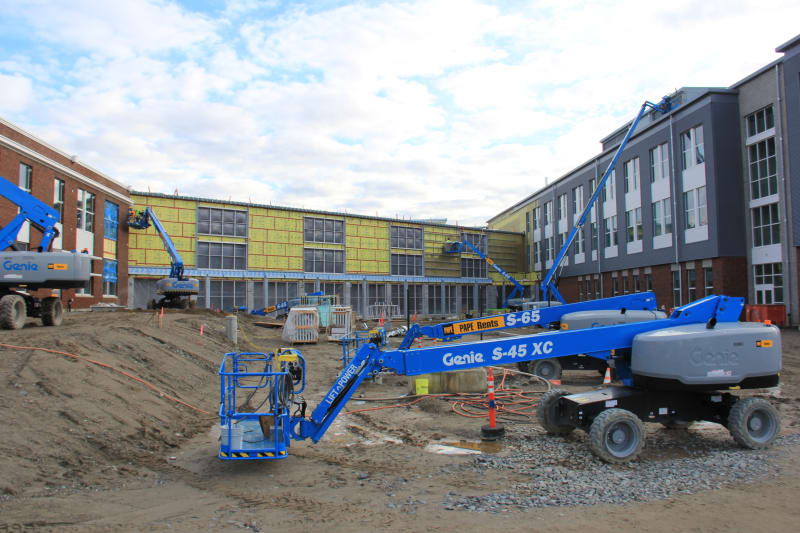 View looking east into the west courtyard, with the commons linking the north and south wings of the new HHS.