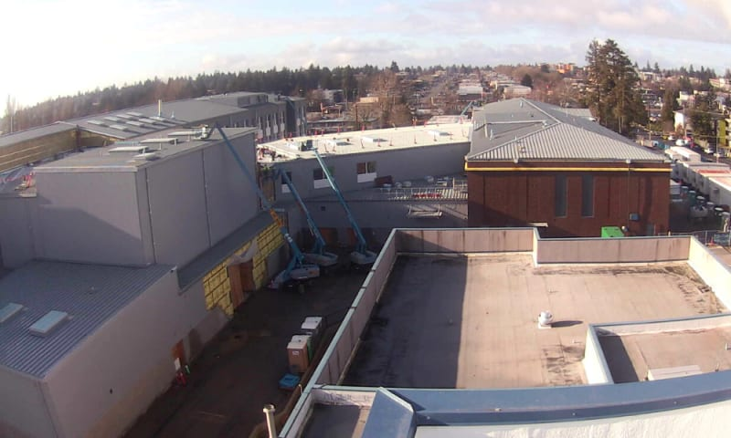 View looking west from the PAC roof (right to left) of the north wing, commons, theater and north wing.