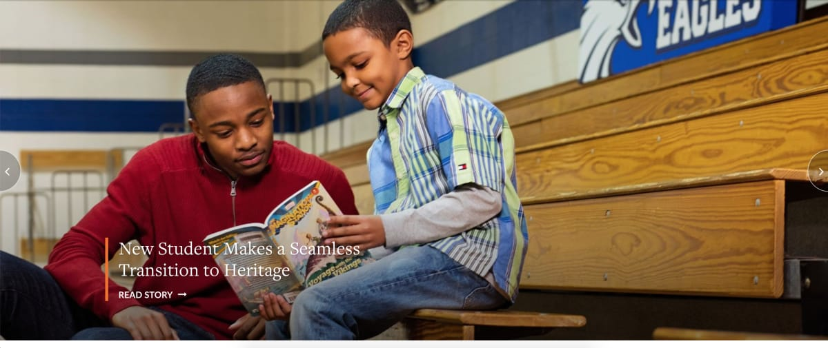 Heritage Christian School homepage photo of student reading with younger boy