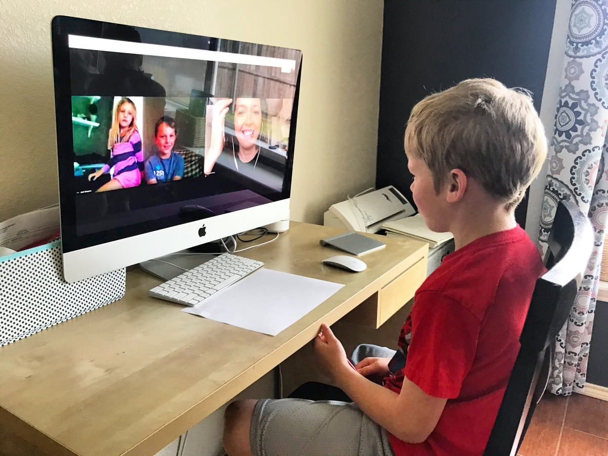 student on computer at home