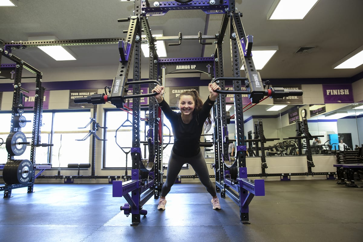 Female athlete working out in the weight room