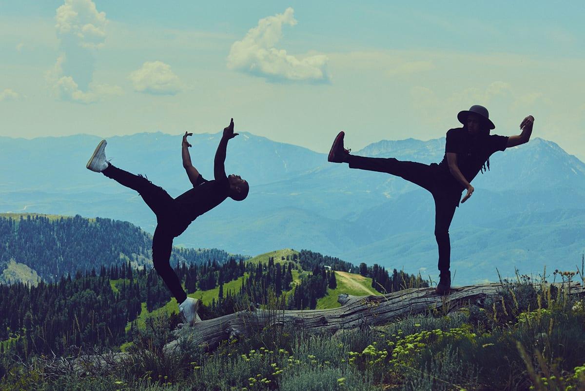 men dancing in field