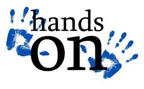 The words 'hands on' written in black lettering on a white background with a blue handprint on each side.