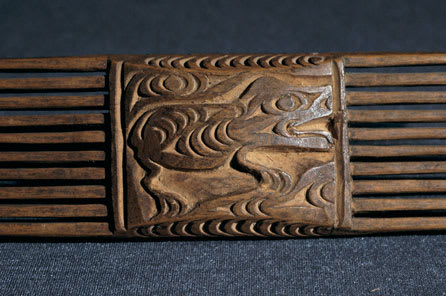 Coast Salish carved comb. On one side a four-legged animal is shown with a clear profile