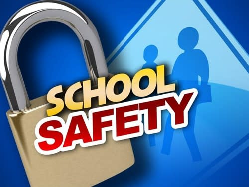 Graphic with lock and sign in the background with ''School Safety'' written in yellow and red.
