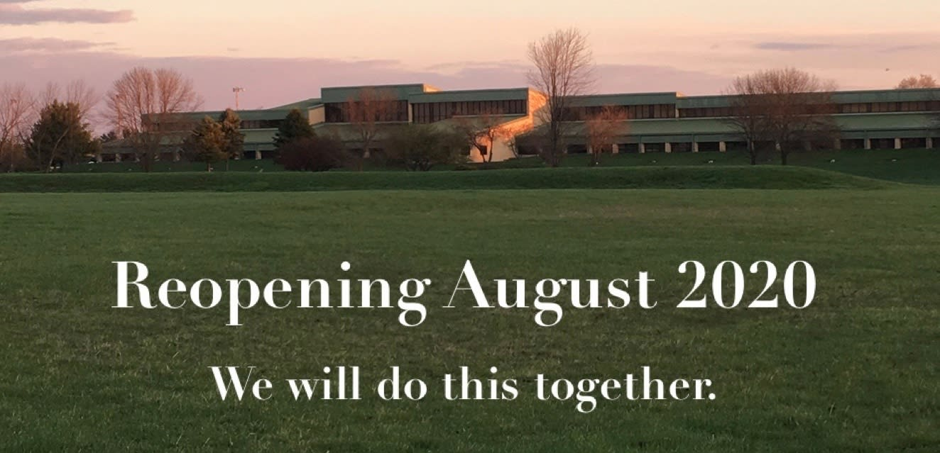 Picture of the front of James Cole Elementary School with ''Reopening August 2020: We will do this together.