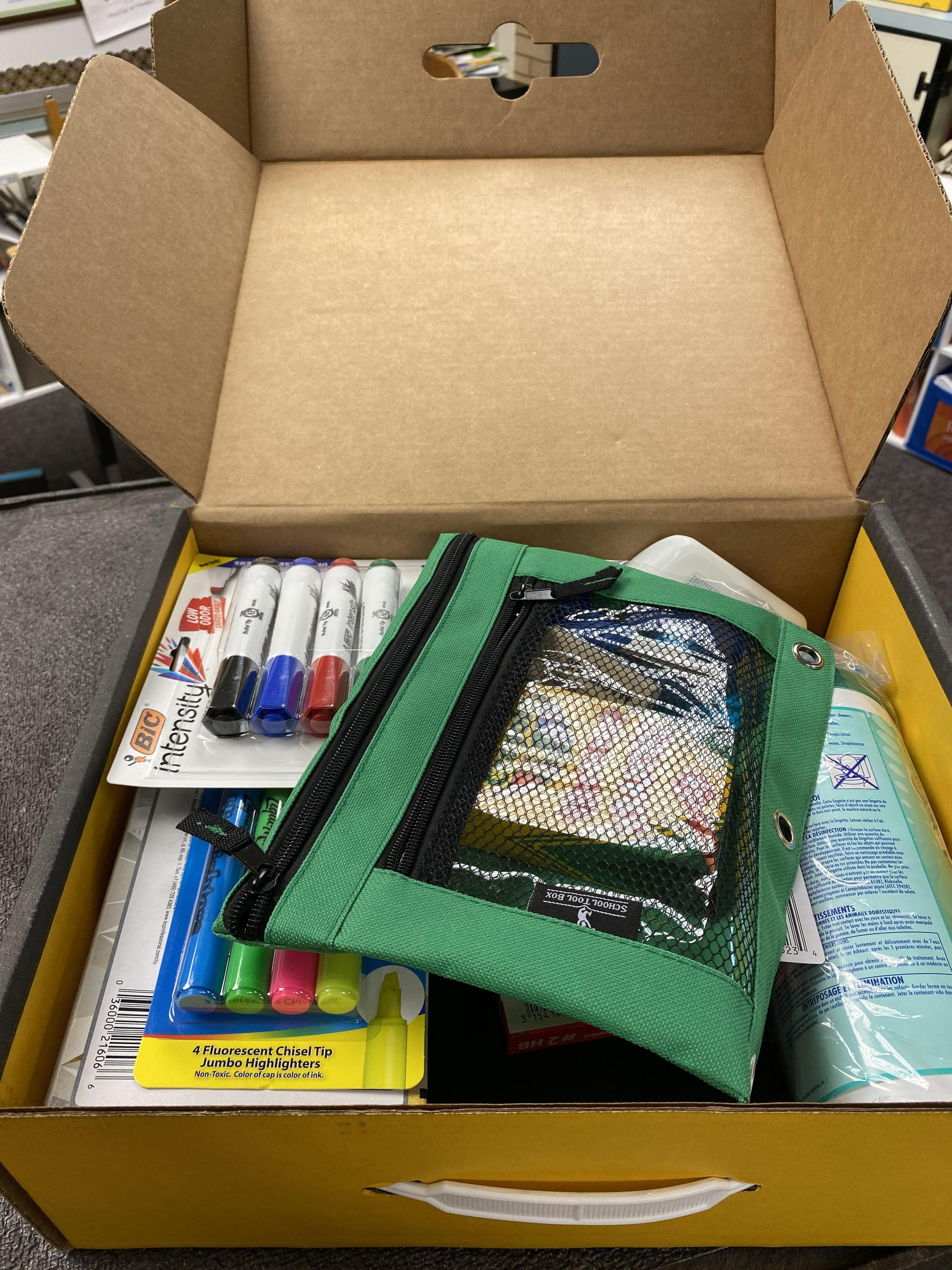 Picture of School Supplies inside a school supply box