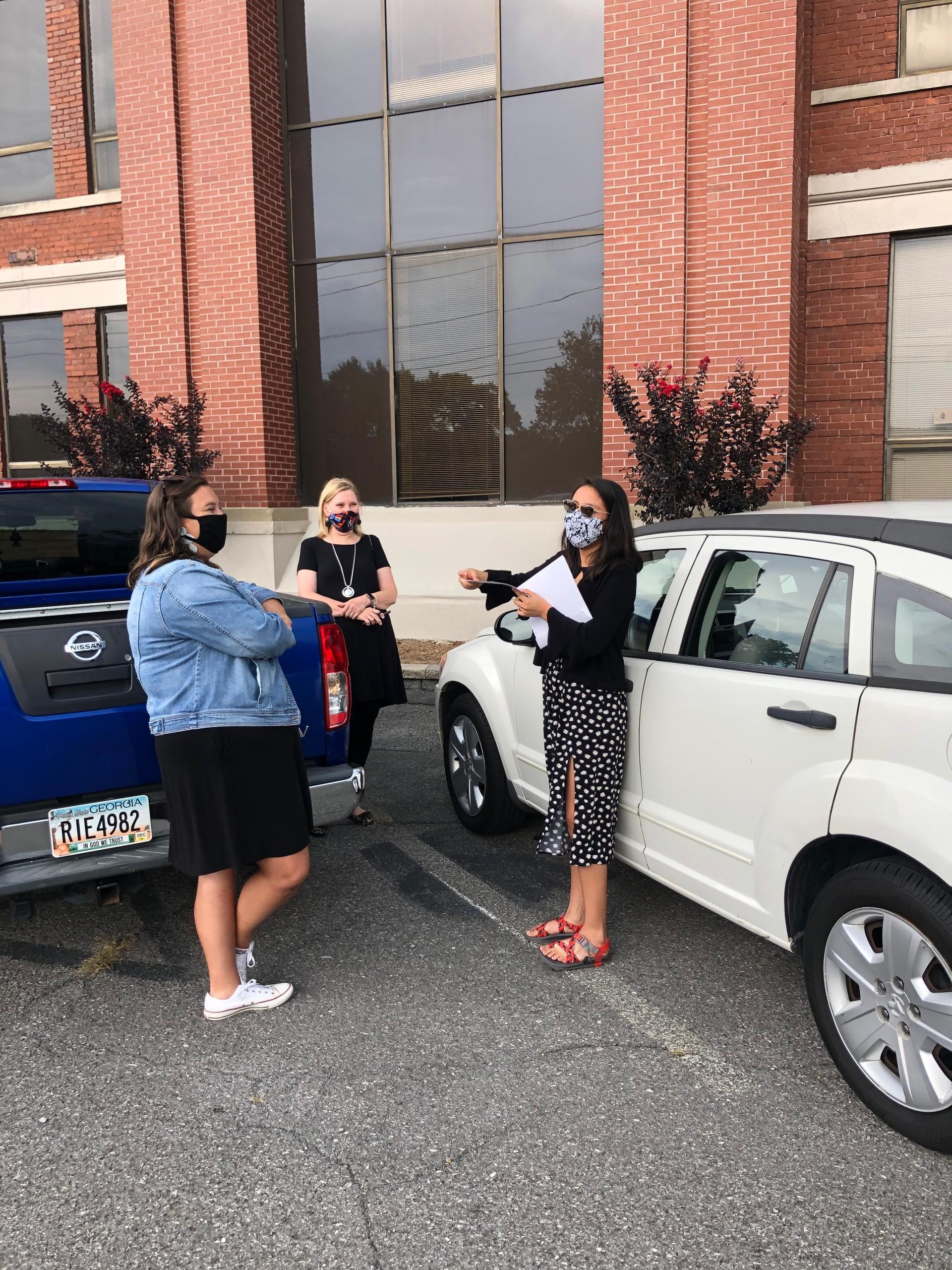 Courtney Taylor giving car to student