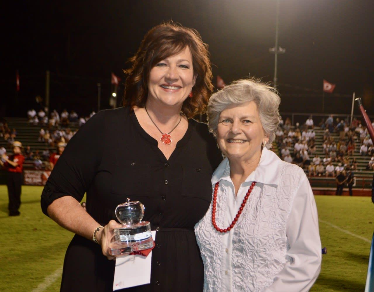 Cindy Parrott receiving award