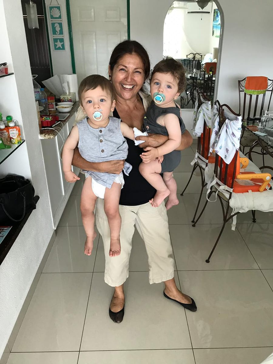 SMCS teacher, Dr. Peter Zavodny's nanny holding his twin sons in Mexico.