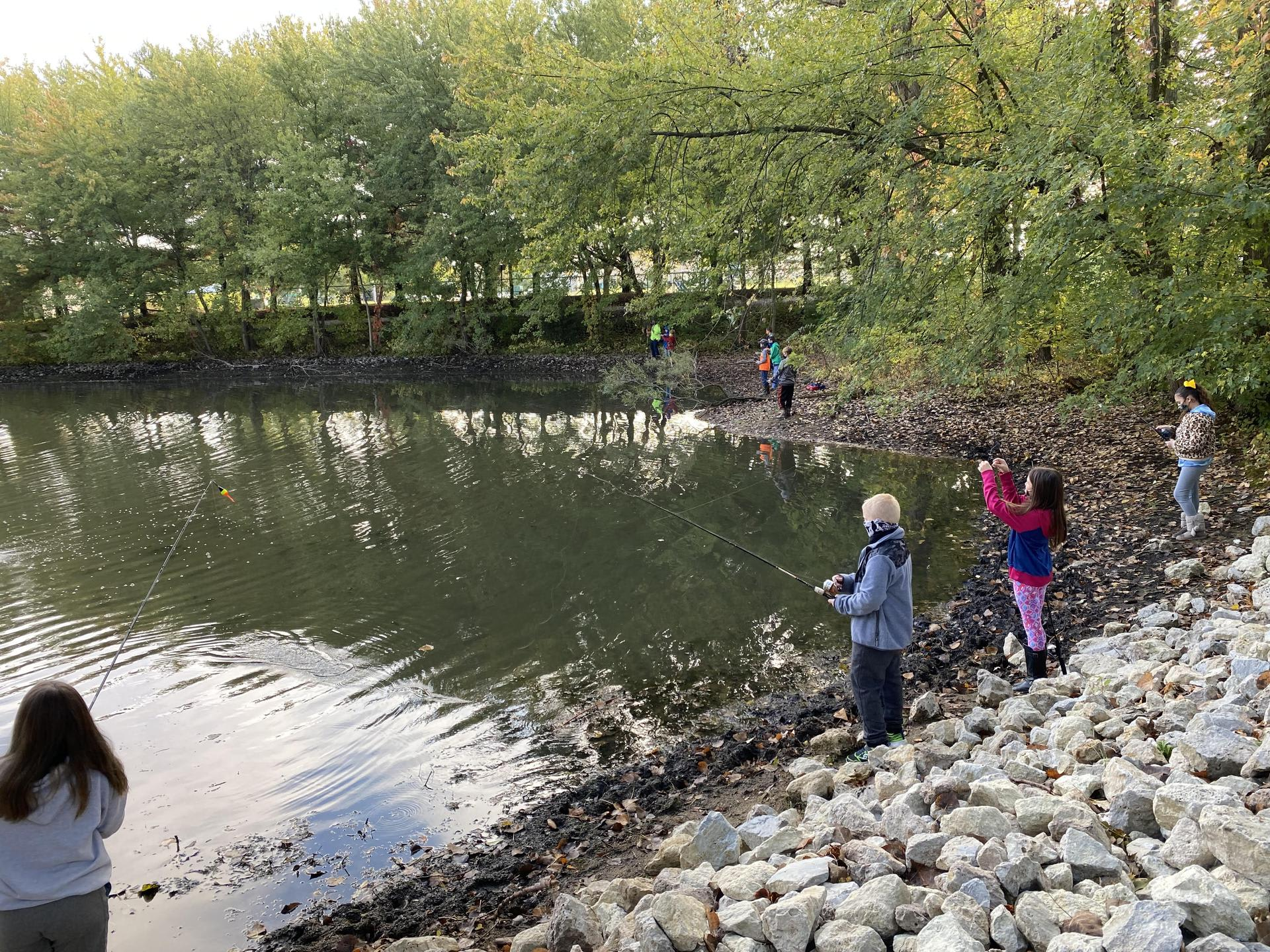 Picture of fifth graders fishing at the Cole Outdoor Education Center pond.