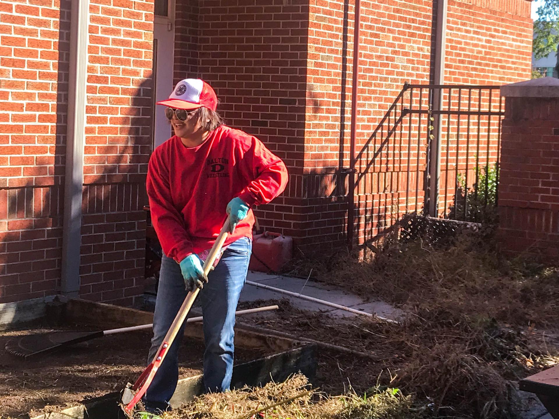 City Park staff member raking leaves