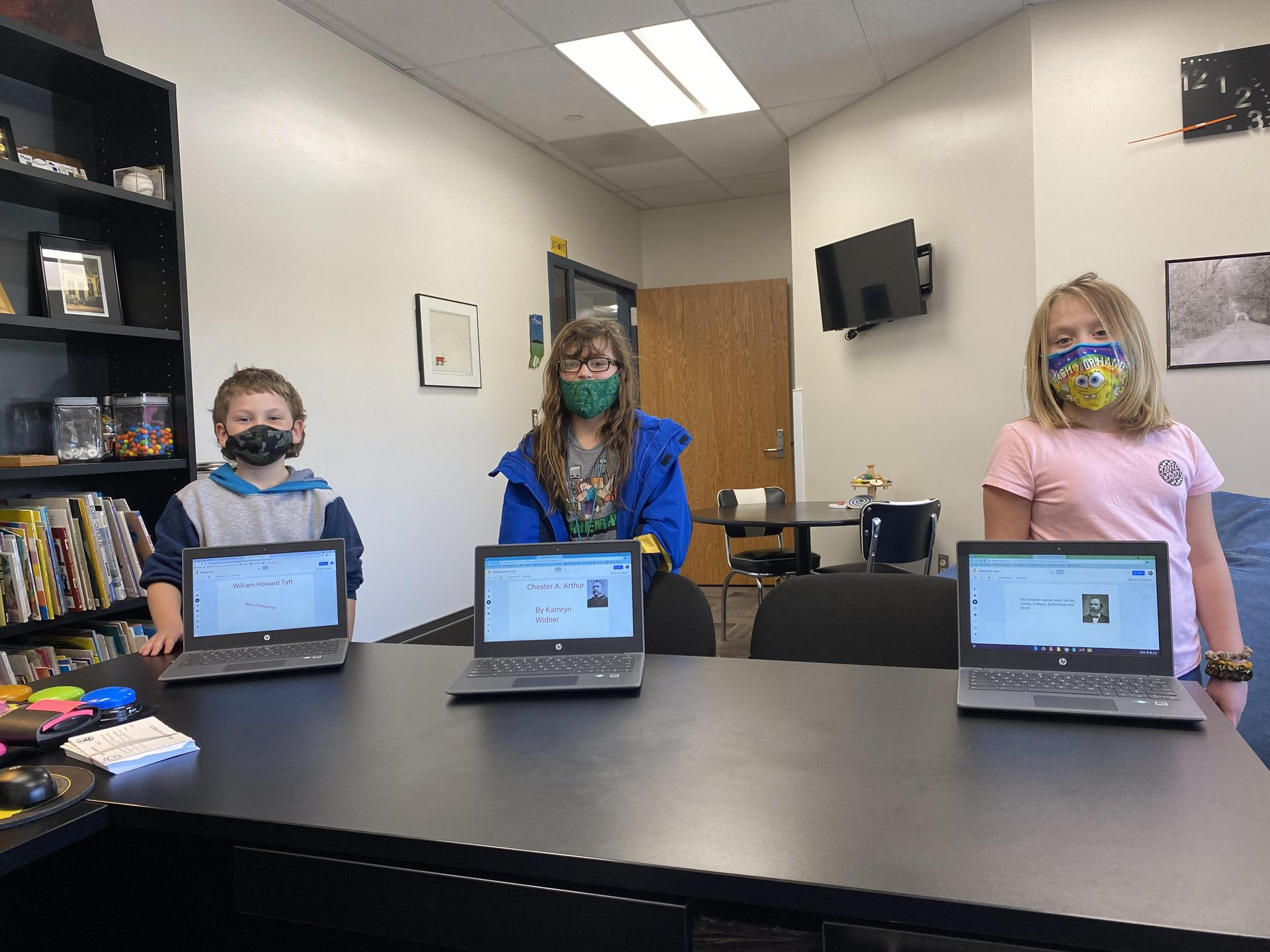 Three students from second grade display their Jamboards on their Chromebooks