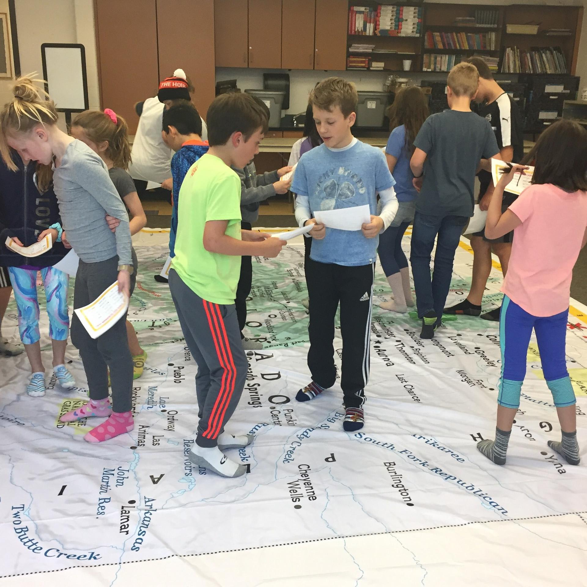 students learning on big map