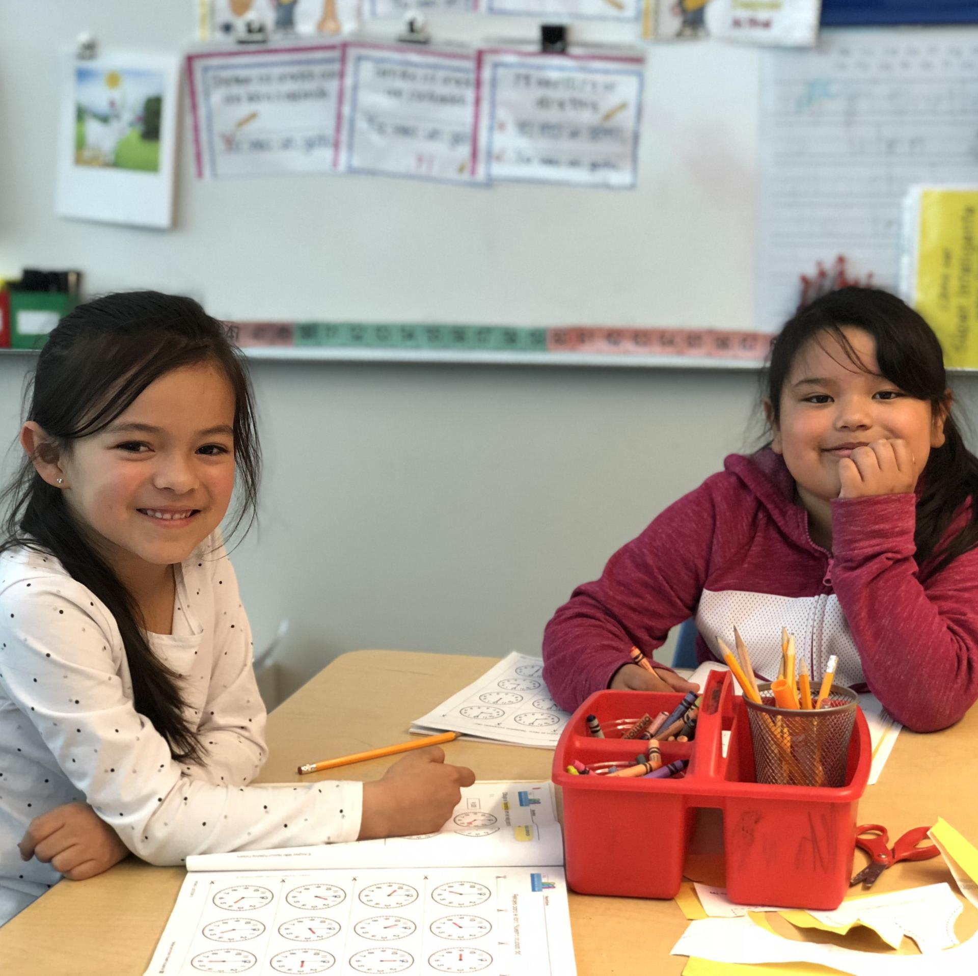 2 students in class smiling