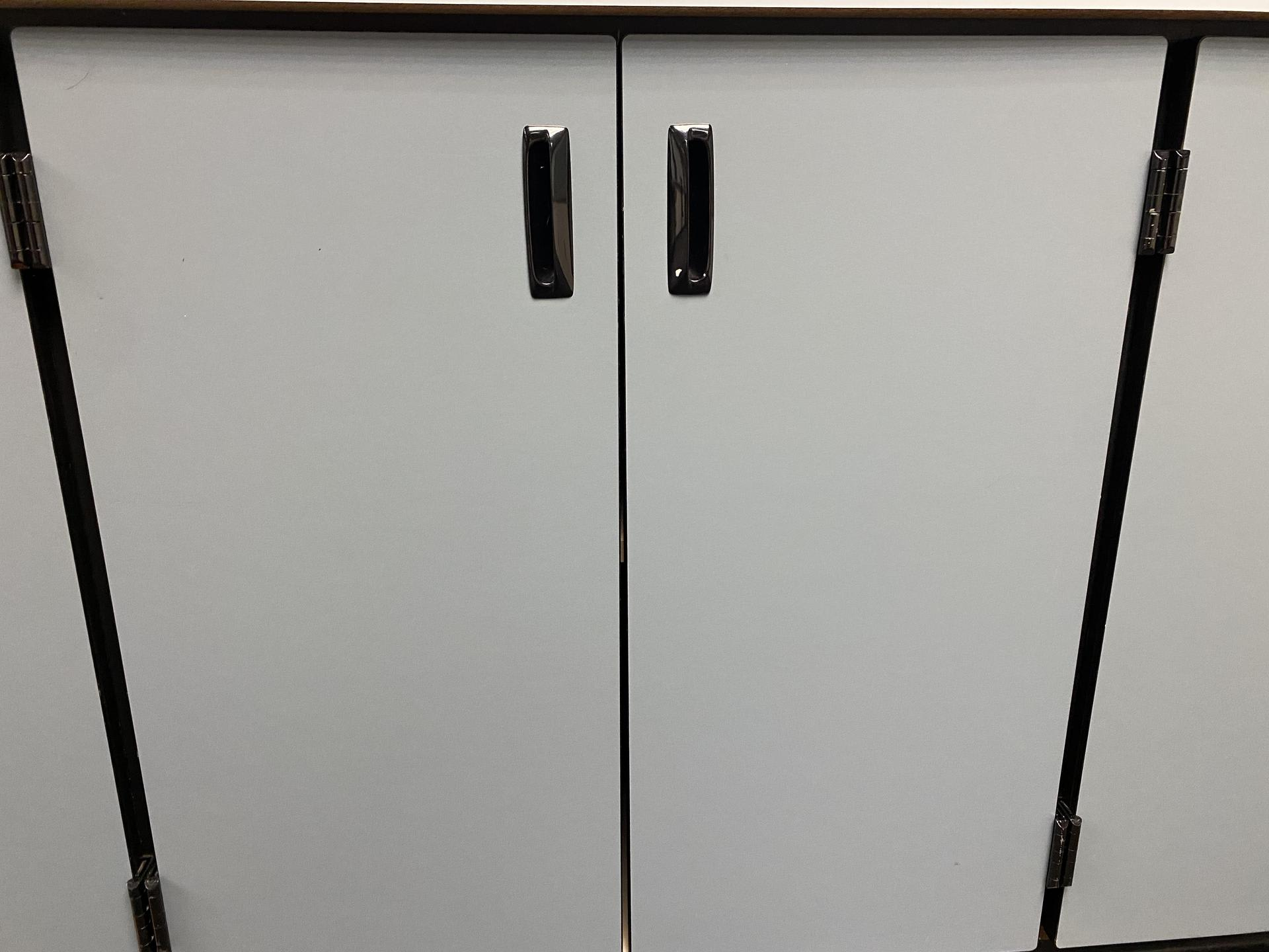 Picture of blue cabinet doors from a classroom