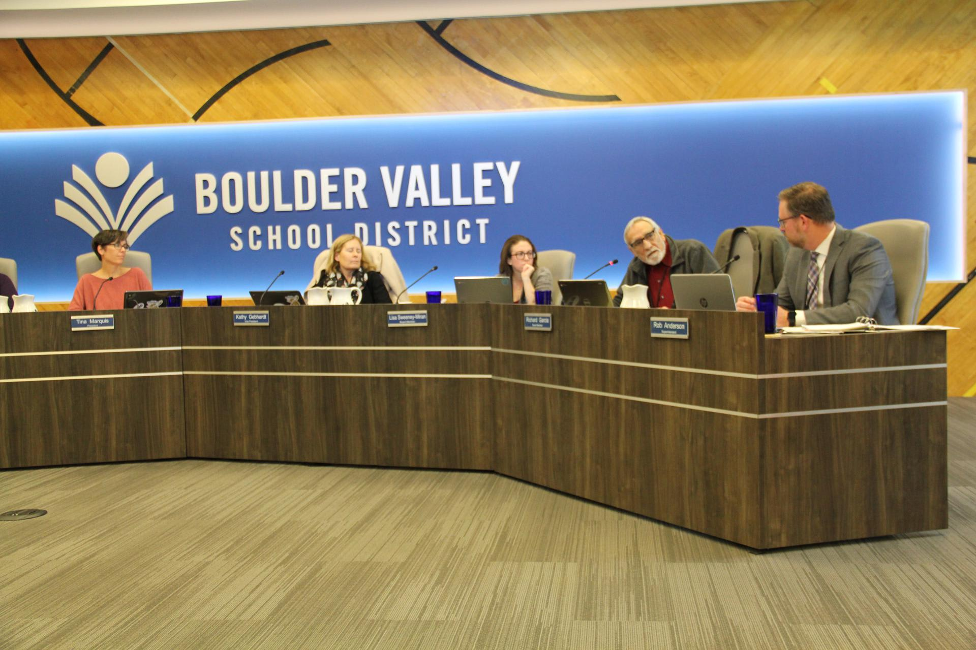 Board members during meeting