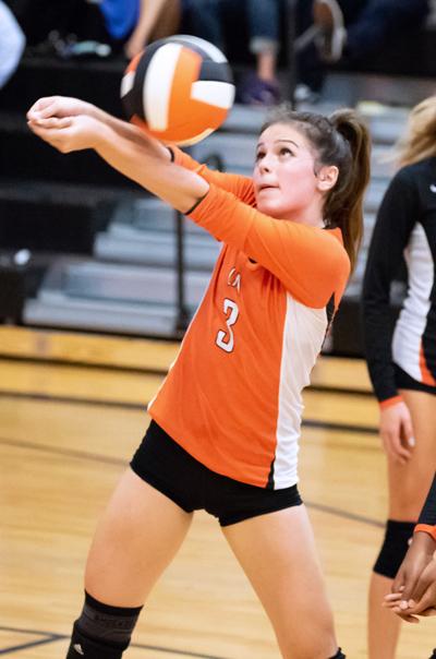 LFA Varsity girls volleyball player volleying the ball upward