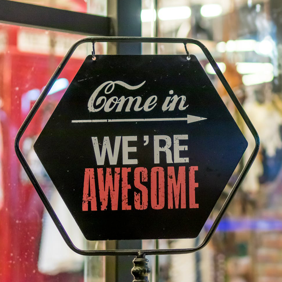 We're awesome store sign