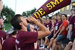 student holds megaphone